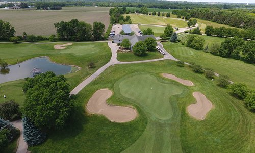 #18, clubhouse, #9 green, and #1 tee
