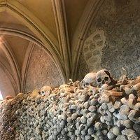 Thigh bones and skulls piled high