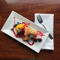 Banana spring rolls with mango gelato and berries