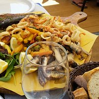 Fresh fritto misto with a glass of white wine