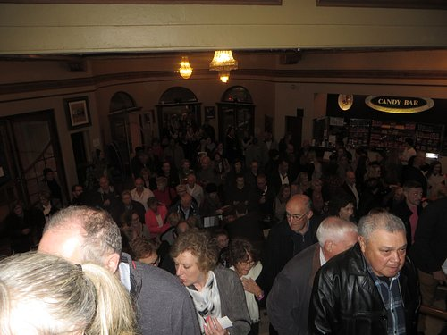 Quiet queues climbing the stairs from the foyer to the Victoria dress circle