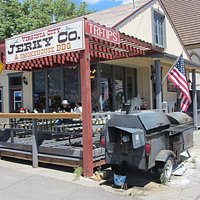 Virginia City Jerky Co. - Outdoor seating and smoker in front