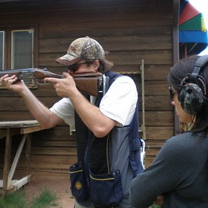Shoot moving clay targets with private shotgun instruction