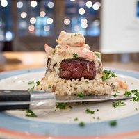 Hand cut USDA Certified Black Angus Filet, topped with fresh Lobster!