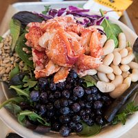 Get your greens in with our Wild Blue salad, topped with lobster meat or your fave seafood!