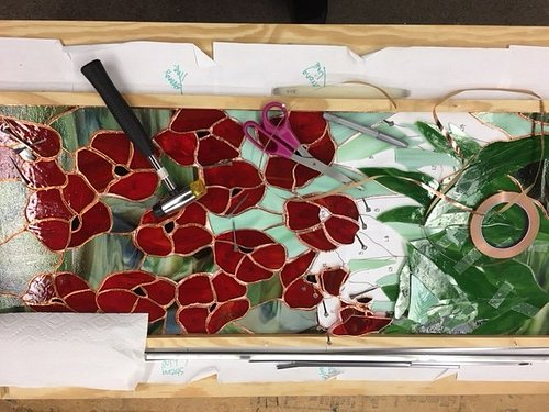 A stained glass piece made during class at the Studio