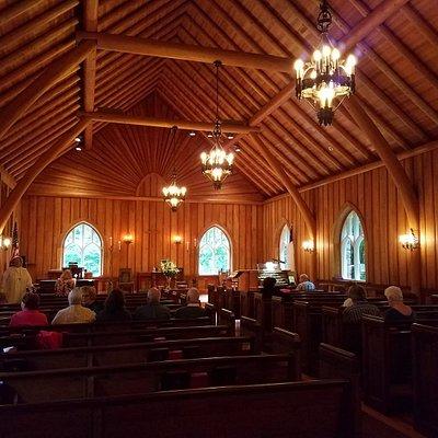 Big Moose Community Chapel before Sunday service. Inside the lakeside stone chapel where a wonde