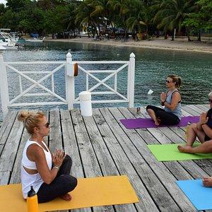 Santosha Beach Yoga on The Beach House dock in West End.