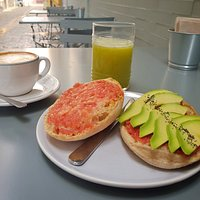 Tomato and avocado toast with green apple, kiwi, pineapple and mint cold pressed juice.