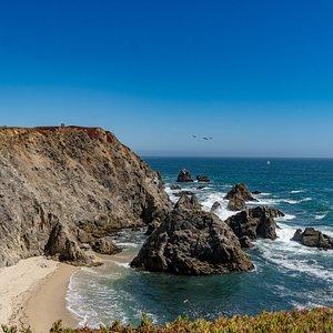 Secluded beach beneath cliffs