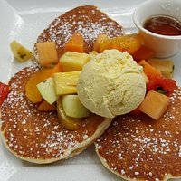 Buttermilk pancakes with fresh fruit & hot maple syrup.