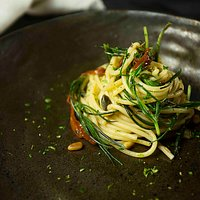Sea weed spaghetti, with sun-dried tomatoes, pine nuts, olives, capers & lime.