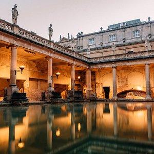 The torchlit Great Bath