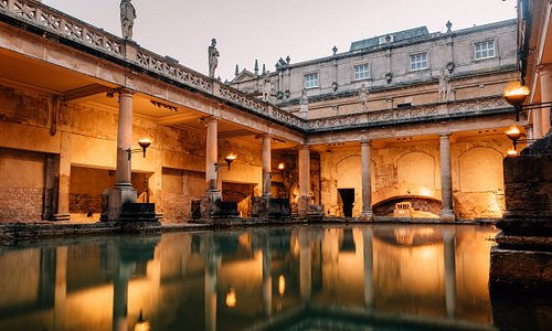 The torchlit Great Bath