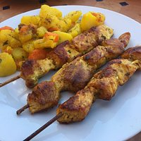 Chicken brochettes with potatoes