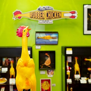 The logo and a stained glass rubber chicken.
