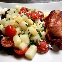 White asparagus with baked goat cheese wrapped in bacon