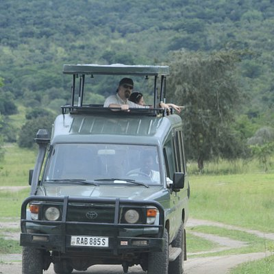 The game drive Picnic in Akagera park makes tourists enjoying a magic view from lakes down hills
