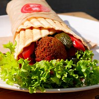 falafel wrap with fresh vegetables and homemade sauces