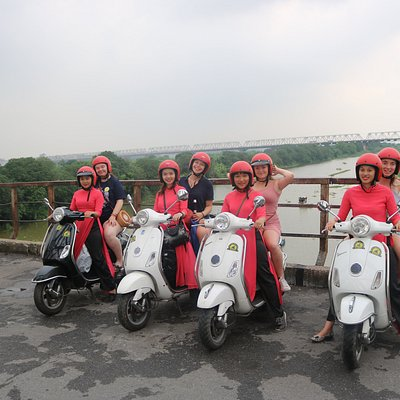 ride vespa to see long bien bridge