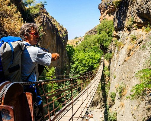 Adventure Waterfall Tour: A picturesque walk through the mountains crossing wire bridges, waterf