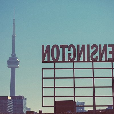 Gazing at the CN tower from the Kensington Market