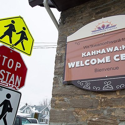 Welcome center front sign with a stop sign in the Mohawk language