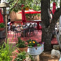 Plenty of outdoor seating with beautiful flowers and shade