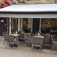Our new outdoor seating area. A lovely spot to enjoy the sunshine. Full table service.