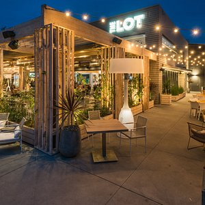 Outdoor patios with fire pits and heaters.
