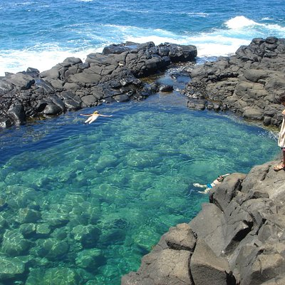 Amazing place to swim with waves crashing over lava rocks and sea turtles swimming near by.