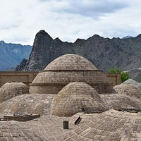 The bath's domes; on the background the rugged mountains surrounding the valley