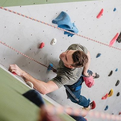 A guest climbing one of the gym's top-rope routers.