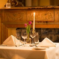 Candlelit dining in the main restaurant at Woolley Grange