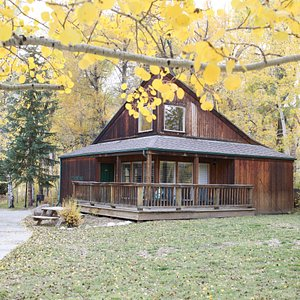 Mt. Harvard Chalet has a big grassy lawn in front that leads to the creekside