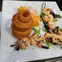 Shrimp Skewers with onion rings and coconut sweet potato mash