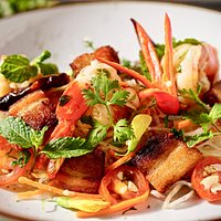 Pork belly and tiger prawn spicy noodle salad special. A kiss of zest and heat.