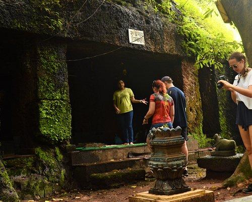 Travelers exploring caves with Mrinmayee Thakur