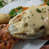 20 oz Florida Lobster tail, stuffed with crab and topped with Hollandaise