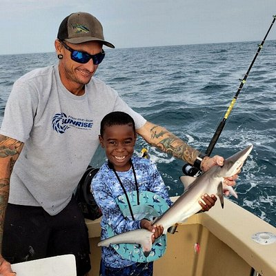 This kid enjoyed his day on the water picture here with a nice shark.