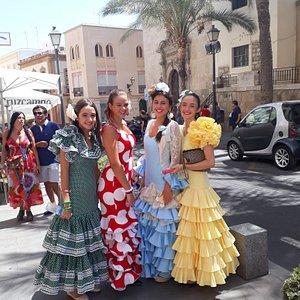Traditionally dressed fiesta revelers