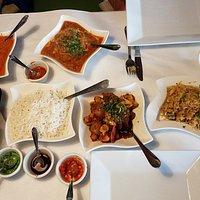 Lamb korma, Assorted naan, chicken biryani, cauliflower, chutneys