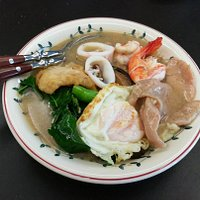 Hofun radna with seafood and fried egg