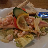 Smoked trout with shrimps and salad