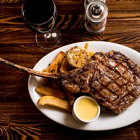 Grilled 30oz Tomahawk Ribeye - served w/truffle fries & garlic aioli