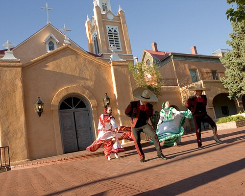 Folklorico dancers in front of historic San Felipe de Neri Church.
