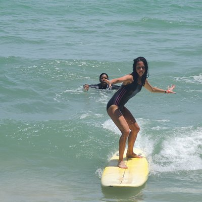 Fun, safe and a great feeling! Surfing at Bang Tao Beach.