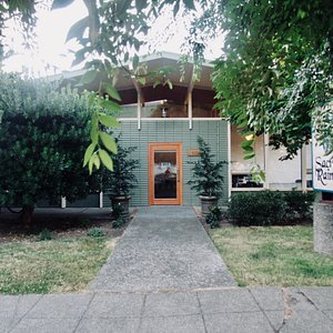 A quaint, tree-shrouded entry in Ballard's brewery district welcomes you inside.