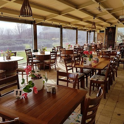 Seating area with views out to garden and vineyard. Every table has a view.
