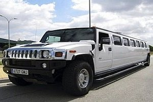 White Hummer, used for airport to city transfers